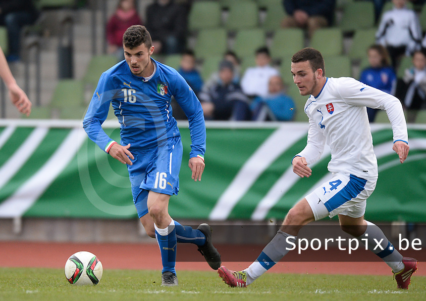 20150323 - MARBURG , GERMANY  : Italian Patrick Cutrone (left) pictured in action with Slovakian Andrej Strba (right) during the soccer match between Under 17 teams of Slovakia and Italy , on the second matchday in group 8 of the UEFA Elite Round Under 17 at Georg-Gassmann , Marburg Germany . Monday 23 rd  March 2015 . PHOTO DAVID CATRY