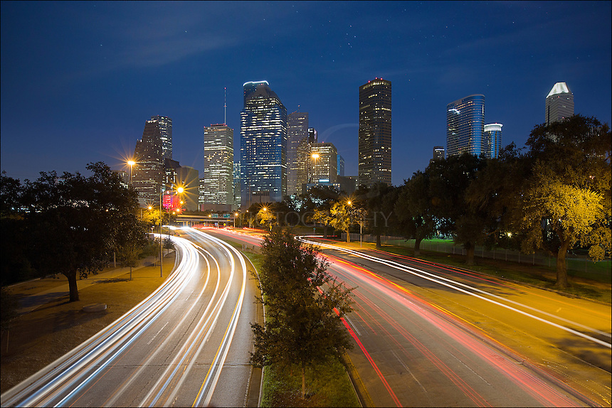 From a small pedestrian bridge that spans Allen Parkway, this image shows the city traffic and Houston Skyline on a September evening This vantage point of downtown offers a unique perspective as cars go back and forth. With over 2 million folks in downtown, I enjoyed my little respite above the evening rush hour!