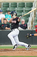 Hunter Jones (1) of the Kannapolis Intimidators follows through on his swing against the Hagerstown Suns at CMC-Northeast Stadium on May 31, 2014 in Kannapolis, North Carolina.  The Intimidators defeated the Suns 3-2 in game one of a double-header.  (Brian Westerholt/Four Seam Images)