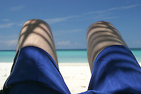 Laying on the beach is a nice way to spend several hours. West Bay, Roatan, Honduras.