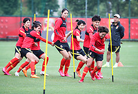 14th May 2020, Suzhou, southeastern Jiangsu Province of East China;  Wang Shuang 2nd R, player of Chinas womens national football team and her teammates warm up prior to an open training session in Suzhou