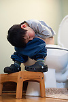 A potty-training Holden Miller, 3, snores loudly after falling asleep while still sitting on the toilet at the Miller/Stute home in Madison, Wis., on Jan. 30, 2011.