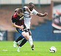 Caley's Liam Polsworth and Raith Rovers' Christian Nade challenge for the ball.