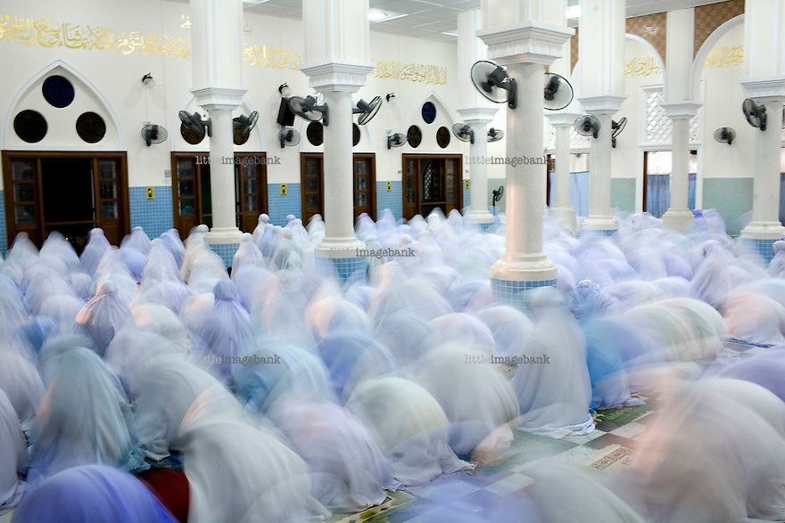 Women during friday prayer in Pattani central mosque. Thailand is struggling to keep up appearances as the land of smiles has to face up to its troubled south. Since 2004 more than 3500 people have been killed and 4000 wounded in a war we never hear about. In the early hours of January 4th 2004 more than 50 armed men stormed a army weapons depot in Narathiwat taking assault rifles, machine guns, rocket launchers, pistols, rocket-propelled grenades and other ammunition. Arsonists simultaneously attacked 20 schools and three police posts elsewhere in Narathiwat. The raid marked the start of the deadliest period of armed conflict in the century-long insurgency. Despite some 30,000 Thai troops being deployed in the region, the shootings, grenade attacks and car bombings happen almost daily, with 90 per cent of those killed being civilians. Photo: Christopher Olssøn