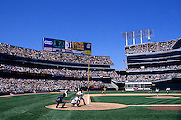 OAKLAND, CA - General stadium overall view of the Oakland Coliseum with Mark McGwire at bat during a baseball game involving the Oakland Athletics in 1997 in Oakland, California. Photo by Brad Mangin