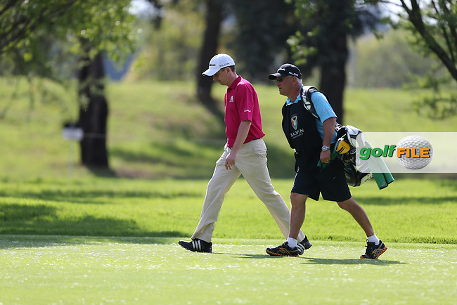 Peter Lawrie (IRL) and caddie walking the 15th during Round Two at the SA Open Championship 2013 at the Glendower Golf Club, Ekurhuleni, Johannesburg, South Africa. Picture:  David Lloyd / www.golffile.ie