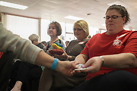 NWA Democrat-Gazette/CHARLIE KAIJO Candice James 0f Bentonville (from right), Gini Cocanower of Lowell and Sue Shoff of Bella Vista look at embroidery samples during a sewing and embroidery lesson, Friday, March 16, 2018 at the Rogers Sewing Center in Rogers. <br /><br />The Oklahoma Embroidery Supply &amp; Design hosted an informational class where participants learned about embroidery tips and techniques. About 40 people attended the day's event. The event will continue on Saturday from 10-4pm