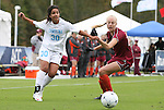 03 November 2010: UNC's Ranee Premji (30) sends the ball in past VT's Brittany Popko (right). The University of North Carolina Tar Heels defeated the Virginia Tech Hokies 4-2 at Koka Booth Stadium at WakeMed Soccer Park in Cary, North Carolina in an ACC Women's Soccer Tournament Quarterfinal game.