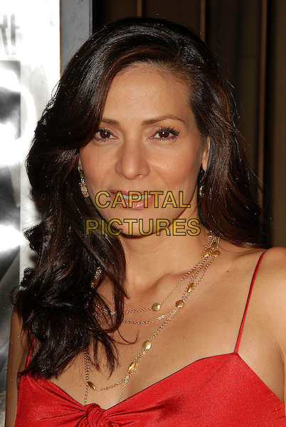 CONSTANCE MARIE.attends The Warner Brothers Pictures Los Angeles Premiere of The Good German held at The Egyptian Theatre in Hollywood, California, USA, December 4th 2006..portrait headshot red dress.CAP/DVS.©Debbie VanStory/Capital Pictures