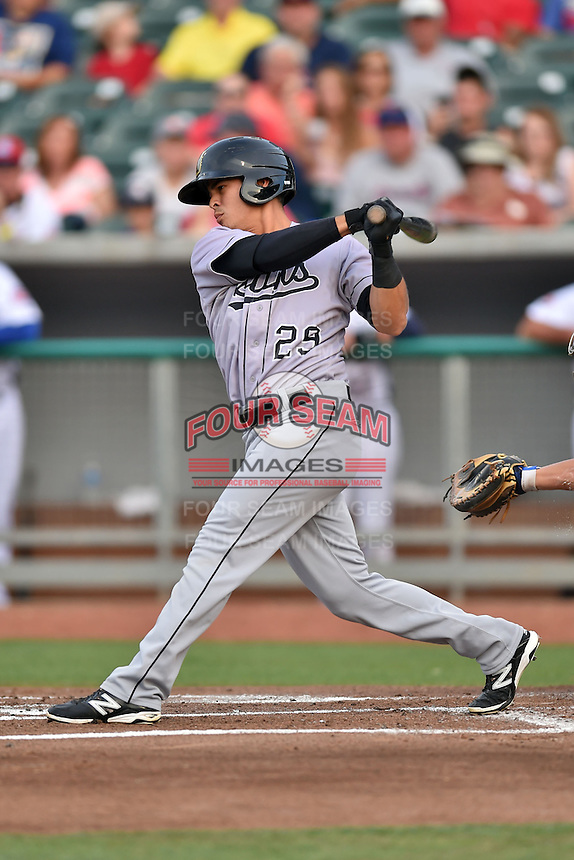 Jacksonville Suns second baseman Terrence Dayleg #29 swings at a pitch during a game against the Tennessee Smokies at Smokies Park July 10, 2014 in Kodak, Tennessee. The Suns defeated the Smokies 6-5. (Tony Farlow/Four Seam Images)