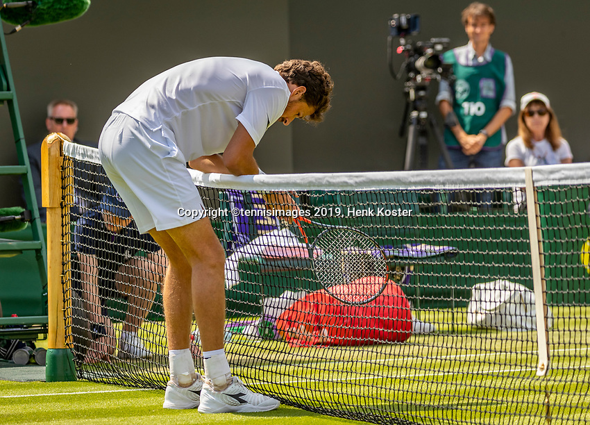 London, England, 3 July, 2019, Tennis,  Wimbledon, Robin Haase (NED) runs to the net and gets injured<br /> Photo: Henk Koster/tennisimages.com
