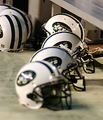 Landover, MD - August 19, 2006 -- New York Jets helmets sit on the ground near the bench during the pre-game activities at FedEx Field in Landover, Maryland, Saturday, August 19, 2006.  The Jets were in Landover to play the Washington Redskins.<br /> Credit: Ron Sachs / CNP