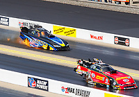 Sep 17, 2017; Concord, NC, USA; NHRA funny car driver Bob Gilbertson (left) has an engine fire alongside Courtney Force during the Carolina Nationals at zMax Dragway. Mandatory Credit: Mark J. Rebilas-USA TODAY Sports