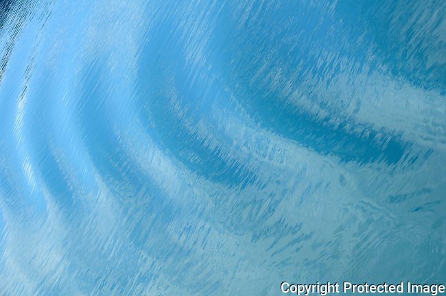 crystal blue waters of Glacier Bay in ripples from a ship's wake