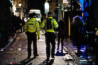 Saturday 21 December 2013<br /> Pictured:Police patroling Carmarthen's King Street<br /> Re: Black Friday Drinkers