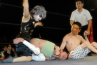 "Wrestlers (left to right) ""Orochi"" ""L'amant"" and ""E.T"". All three suffer from cerebral palsy. Only attacks to their afflicted areas are disallowed."