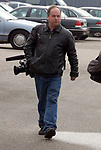 Cameraman ??? at Nassau Co. police HQ in Mineola on Tuesday February 8, 2005, awaiting the arrival of detectives bringing Nicole Pearce an accused accomplice of Chris DiMeo in a series of jewelry robberies and homicides. (Photo copyright Jim Peppler 2004).