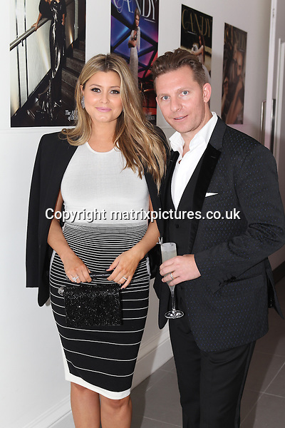 NON EXCLUSIVE PICTURE: TREVOR ADAMS / MATRIXPICTURES.CO.UK<br /> PLEASE CREDIT ALL USES<br /> <br /> WORLD RIGHTS<br /> <br /> British luxury property developer Nick Candy and his pregnant wife, Australian singer Holly Valance attending the CANDY Magazine Autumn/Winter 2013 Launch Party, hosted by Nick Candy at the Saatchi Gallery in King's Road, London.<br /> <br /> OCTOBER 15th 2013<br /> <br /> REF: MTX 136759