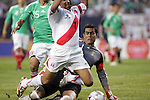 June 08 2008:  Oswaldo Sanchez (Santos) (behind) tackles the ball away from Leao Butron (Universidad San Martin) (1) of Peru.  During the third and final match of Mexico's 2008 USA Tour in preparation for qualification for FIFA's 2010 World Cup, the national soccer team of Mexico defeated Peru 4-0 at Soldier Field, in Chicago, IL.