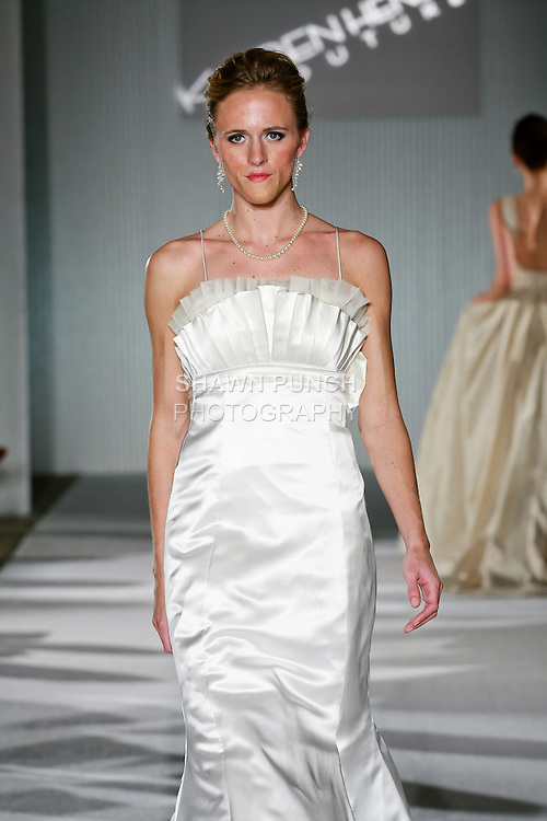 Model walks the runway in a Karen Hendrix Couture Ava wedding dress by Karen Hendrix during the Wedding Trendspot Spring 2011 Press Fashion, October 17, 2010.