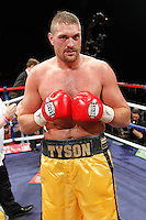 Tyson Fury (gold shorts) defeats John McDermott to win the English Heavyweight Boxing Title at the Brentwood Centre, Essex, promoted by Frank Maloney / FTM Sports - 25/06/10 -