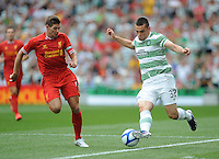 10th August 2013; Tony Watt, Glasgow Celtic, in action against Steven Gerrard, Liverpool. Pre-season Friendly, Liverpool v Celtic, Dublin Decider, Aviva Stadium, Dublin. Picture credit: Tommy Grealy/actionshots.ie.