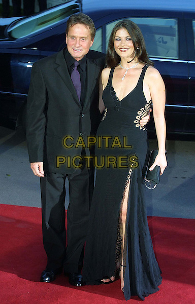 MICHAEL DOUGLAS & CATHERINE ZETA JONES.Arriving For Dinner at Laureus Sports Awards In The Sporting d'EtE..celebrity couple, married, plunging neckline, full lemth, full-length.www.capitalpictures.com.sales@capitalpictures.com.Supplied By Capital Pictures