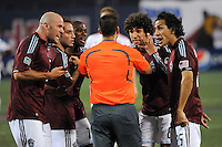 Colorado Rapids players including Conor Casey (9), Mehdi Ballouchy (8) and Pablo Mastroeni (25) yell at referee Ricardo Salazar. The Colorado Rapids defeated the New York Red Bulls 3-2 during a Major League Soccer match at Giants Stadium in East Rutherford, NJ, on May 30, 2009.