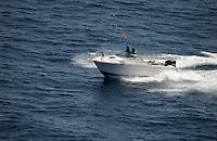 Two men in speed boat, La Gomera, Canary Islands.