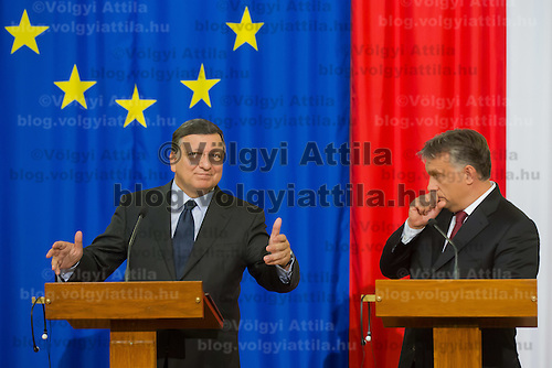Jose Manuel Baroso (L) President of the European Commission and Viktor Orban (R) prime minister of Hungary talk during a press conference in Budapest, Hungary on September 11, 2014. ATTILA VOLGYI