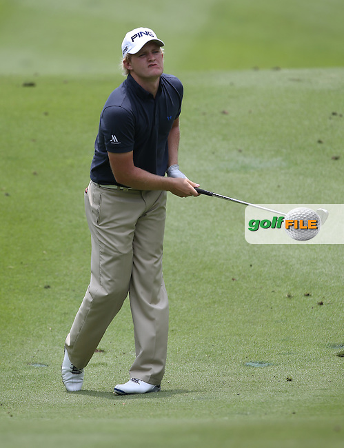 A 71 sees Tom Lewis (ENG) make the cut but lies 10 shots behind the leader Lee Westwood (ENG) during Round Two of the 2014 Maybank Malaysian Open at the Kuala Lumpur Golf & Country Club, Kuala Lumpur, Malaysia. Picture:  David Lloyd / www.golffile.ie