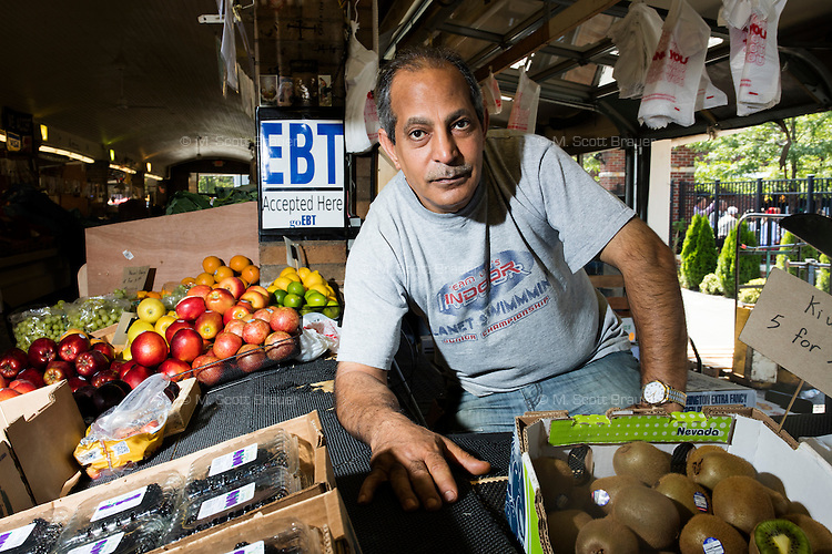 Egyptian immigrant Morad Botros Makar came to the US 8 months ago and owns a fruit stand in Cleveland's West Side Market.