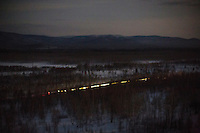 The Matvei Mudrov train travelling through the taiga at night. It usually travels during the night and is then ready for service in the morning in one of the hundreds of villages along the route of the Baikal Amur Magistral (BAM) railway. <br /> <br /> The Matvei Mudrov train is a medical train operated by Russian Railways along the course of the Baikal Amur Magistral (Baikal-Amur Mainline, or BAM) railway line. Named after a famous 19th century Russian physician, the train employs around 15 doctors who make about 10 trips a year, each lasting two weeks. Along the way they deliver essential medical services to people living in remote villages along the 4,324 km long BAM railway. Though not equipped to carry out surgical procedures the train has heart monitors, ultrasound and x-ray machines to deliver diagnosis.