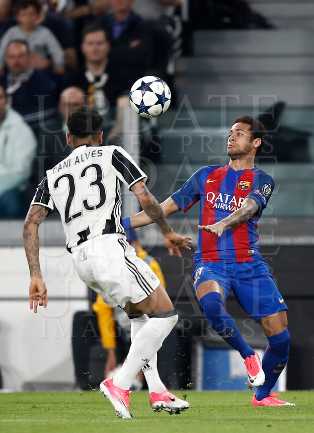 Football Soccer: UEFA Champions UEFA Champions League quarter final first leg Juventus-Barcellona, Juventus stadium, Turin, Italy, April 11, 2017. <br /> Barcellona Neymar (r) in action with Juventus Dani Alves (l) during the Uefa Champions League football match between Juventus and Barcelona at the Juventus stadium, on April 11 ,2017.<br /> UPDATE IMAGES PRESS/Isabella Bonotto