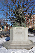 Nathaniel Hawthorne statue in Salem, Massachusetts, USA during the winter months. He is best known for The Scarlet Letter and The House of the Seven Gables