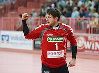 Handball 1. Bundesliga  2012/2013  in der Paul Horn Arena Tuebingen 08.09.2012 TV Neuhausen - TSV Hannover-Burgdorf Torwart Martin Ziemer (TSV Hannover) jubelt