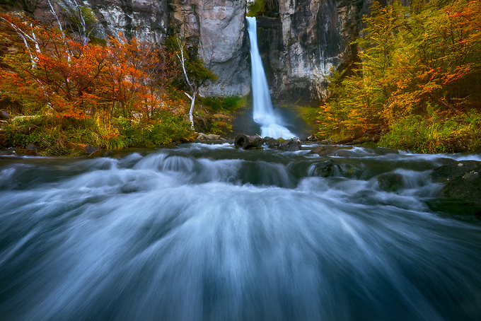 Fall color frames this iconic waterfall near El Chalten, Argentina.