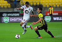 Keanu Baccus gets past Liberato Cacace during the A-League football match between Wellington Phoenix and Western Sydney Wanderers at Westpac Stadium in Wellington, New Zealand on Saturday, 3 November 2018. Photo: Dave Lintott / lintottphoto.co.nz