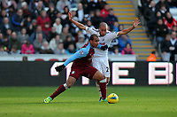 Pictured: Jazz Richards of Swansea (R) against Gabriel Agbonlahor of Aston Villa (L). Sunday 27 November 2011<br /> Re: Premier League football Swansea City FC v Aston Villa at the Liberty Stadium, south Wales.