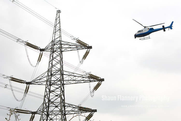 Pix: Shaun Flannery/shaunflanneryphotography.com..COPYRIGHT PICTURE>>SHAUN FLANNERY>01302-570814>>07778315553>>..14th April 2010...........A National Grid helicopter checks out pylons near Barnsley, South Yorkshire.