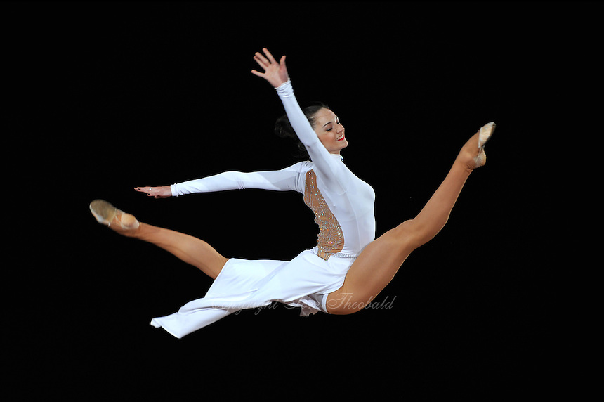 September 13, 2009; Mie, Japan;  Anna Bessonova of Ukraine split leaps during gala exhibition at 2009 World Championships Mie. This was the first of two galas with Anna and featured her in white chiffon and accompanied by the Ukrainian rhythmic group (not in frame). Photo by Tom Theobald. .
