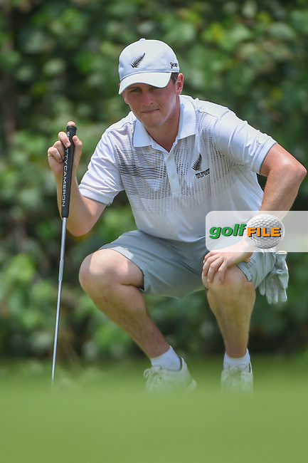 Matthew McLEAN (NZL) lines up his putt on 4 during Rd 2 of the Asia-Pacific Amateur Championship, Sentosa Golf Club, Singapore. 10/5/2018.<br /> Picture: Golffile | Ken Murray<br /> <br /> <br /> All photo usage must carry mandatory copyright credit (© Golffile | Ken Murray)