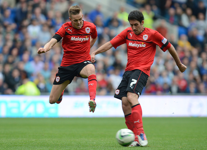 Cardiff City's Craig Noone jumps to avoid team mate Peter Whittingham's shot ..Football - npower Football League Championship - Cardiff City v Leeds United - Saturday 15th September 2012 - Cardiff City Stadium - Cardiff..