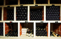 Domaine Cazeneuve in Lauret. Pic St Loup. Languedoc. Bottle cellar. France. Europe. Bottle. Bins with bottles.