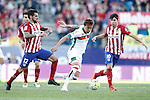Atletico de Madrid's Augusto Fernandez (l) and Oliver Torres (r) and Granada Club de Futbol's Adalberto Penaranda during La Liga match. April 17,2016. (ALTERPHOTOS/Acero)