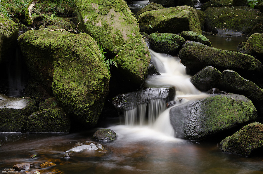 Water Flowing Through Rocks at Padley Gorge
