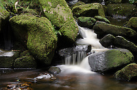 Water Flowing Through Rocks at Padley Gorge