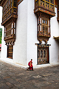 A young lama walks past a huge building next to the monastery at the Punakha Dzong in Punakha, the older capital of Bhutan. Punakha is the administrative centre of Punakha dzongkhag, one of the 20 districts of Bhutan. Photo: Sanjit Das/Panos