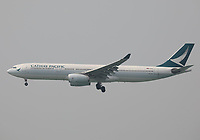 A Cathay Pacific Airbus A330-343 Registration B-LAL landing on Runway 25R at Hong Kong Chek Lap Kok International Airport on 6.4.19 arriving from Perth Airport, Australia.