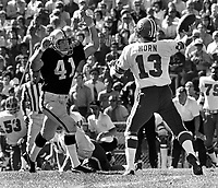 Denver Bronco QB Don Horn, rushed by Oakland Raider linebacker Phil Villapiano. (1973 photo/Ron Riesterer)
